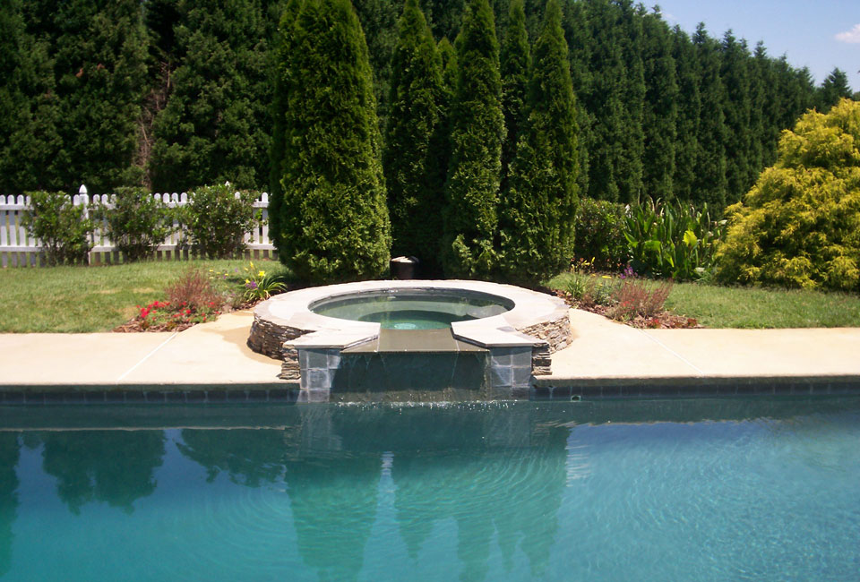 Poolside PA Bluestone Jacuzzi accented w/ 'Emerald Green' Arborvitae, Perennial Garden, Ligustrum & Taller Conifers as backdrop