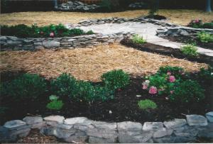 Closer view of small PA Fieldstone Retainers w/ Shrubbery & Sitting Area Patio at End of PA Bluestone Flagstone Walkway