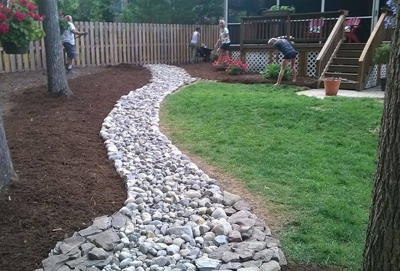 Dry Creek Bed featuring Delaware Valley River Slicks separating Natural Area from Lawn w/ PA Bluestone Thin Veneer Borders